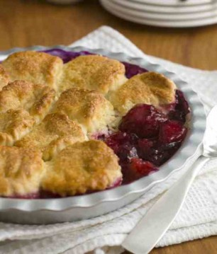 Beige topped cobbler with purple and red filling