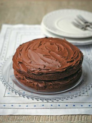 Chocolate cake on plate and tea towel