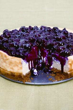 Rich creamy cheesecake cut by a sharper fruit topping simply
