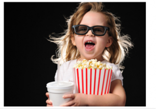 little girl in 3d glasses with popcorn