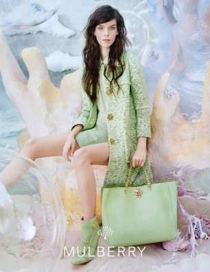 Mulberry Spring Summer Campaign model wears green dress and coat with tote