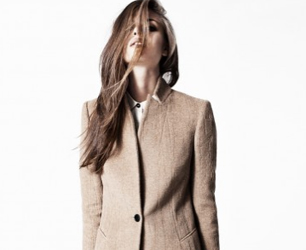 AllSaints SS13 model wears camel coat