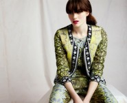 model sitting wearing ASOS Africa SS13 print jacket
