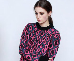 model wears Cécile jumper in pink and black