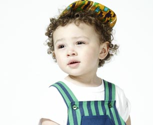 little boy wearing striped dungarees by What Mother Made