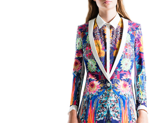 model wears suit jacket and shirt from Clover Canyon in floral print
