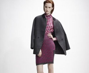 model wears pink top, skirt and grey coat by O2nd