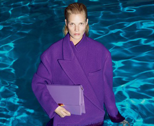 model wears Stella McCartney AW13 purple coat in swimming pool