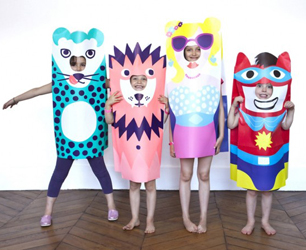 kids wearing OMY paper dress up animal costumes