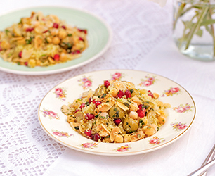Flaked Almond and Chickpea Couscous Salad with Pomegranate Seeds, Olives and Feta