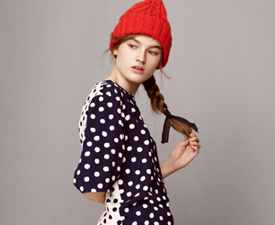 model wears polka dot top and red beanie from ASOS