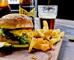 Bukowski Burger with chips and a beer