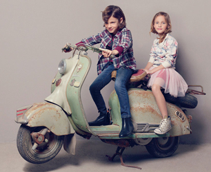 girl and boy on retro scooter