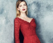 model wears red lace dress