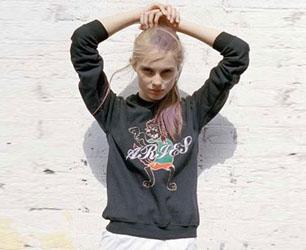 model wears sweatshirt by Aries