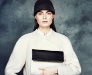 model wears white jumper and shirt for m&s