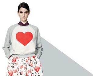 model wears heart print sweater