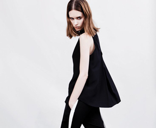 Model wears black top and trousers from Whistles Resort 2014