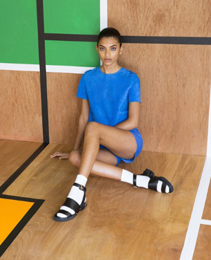 model wearing clothes from Farfetch's Destination Brazil