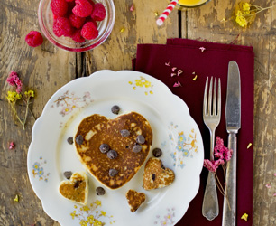 Heart Shaped Chocolate Chip Pancake with Raspberries and Orange Juice