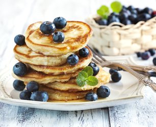 Stack of pancakes with fresh blueberry and honey; Shutterstock ID 281329100; PO: license(25841)